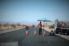 Kicking Back on a Highway (Spebak) Tags: spebak canon canondslr canon70d highway construction waiting flagman stop mojavedesert