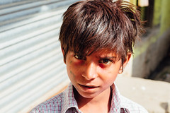 Boy on Street, Mathura India (AdamCohn) Tags: adam cohn uttar pradesh india mathura vrindavan holi pilgrim pilgrimage pilgrimmage pilgrims streetphotographystreetphotographer wwwadamcohncom adamcohn uttarpradesh isapurbanger