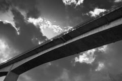 The Dark Bridge (Staffan Olsson) Tags: adventure bridge blackandwhite canon canoneos6d canonef1740mmf4lusm cloud eos ef1740mmf40lusm gothenburg sky monochrome outdoors outdoor road sweden shadow travel