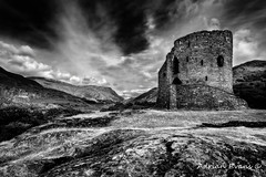 Dolbadarn Castle (Adrian Evans Photography) Tags: ancient welsh snowdonia historic dinorwicslatequarry monument cadw hills dolbadarn welshcastle dolbadarncastle wales llanberispass dinorwigquarry uk northwales quarry architecture castle landscape llanberis landmark mono outdoor clouds castleruin welshlandmark edwardian britain padarn adrianevans ruins snowdonmoutainrange heritage snowdon sky blackandwhite british mountain 5d2 canon on1