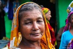 India_2018_132 (albertobuscato) Tags: india woman kolkata slum pose face portrait orange veil calm peace