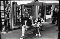 (Espresso Lovers) (Robbie McIntosh) Tags: leicamp leica mp rangefinder streetphotography 35mm film pellicola analog analogue negative leicam summilux analogico leicasummilux35mmf14i blackandwhite bw biancoenero bn monochrome argentique summilux35mmf14i autaut dyi selfdeveloped filmisnotdead kodaktrix400 kodak trix d76 kodakd76 leicasummilux35mmf14 summilux35mmf14preasph street carabinieri eyecontact shadow man woman