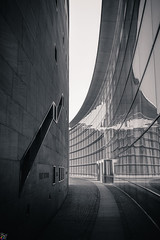 Museum of Art and Design (rckey) Tags: monochrome architecture city modern urban futuristic building street no person light perspective abstract steel window glass dark sky downtown black white nuremberg germany reflection library reflections lines curves way grey