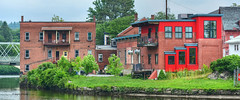 homes on the river (albyn.davis) Tags: massachusetts usa river bridge buildings color red green panorama smalltown village windows balcony