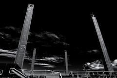 Up! (Alfred Grupstra) Tags: blackandwhite blackcolor dark sky industry people nopeople outdoors twinbarge poles