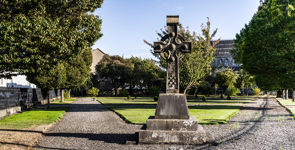 THE FOUR MASTERS MEMORIAL BY JAMES CAHILL [A CELTIC CROSS LOCATED ON SMALL PARK BESIDE THE CHURCH ON BERKELEY ROAD]-144992