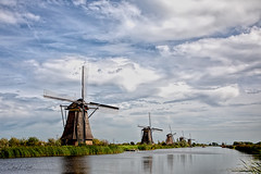 Windmills of Kinderdijk II (cheryl strahl) Tags: europe thenetherlands netherlands holland dutchmasters kinderdijk worldheritagesite rotterdam windmills dutchwatermanagement water watercontrol functioningwindmills pumping pumpingstations clouds