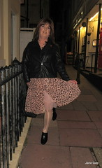 Around the Lanes (janegeetgirl2) Tags: transvestite crossdresser crossdressing tgirl tv ts heels nylons glamour ankle boots summer shirt dress jane gee outside promenade brighton leopard biker jacket black