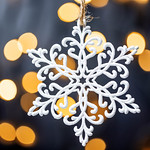 Beautiful snowflake on the background of Golden bokeh thumbnail