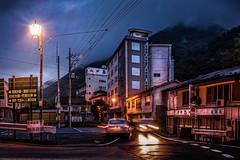 The ghost towns of Japan. (kellypettit) Tags: ghosttown japan ruraljapan oigamionsen countryside bluehour rain longexposure carlights streetlights oldbuildings gunma bubbleera areminder kellypettitphotography
