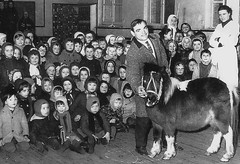 A Visitor (theirhistory) Tags: boy children kids girls jumper trousers wellies boots coat pony horse man hall hat shoes rubberboots school class form pupils