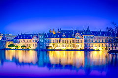 The Famous Binnenhof Palace of Parliament in The Hague in The Netherlands at Blue Hour. (DmitryMorgan) Tags: binnenhof gollandia gollandiya haag hague holland netherlands architecture bluehour buildings denhaag dusk dutch europe evening fountain government governmental historic hofvijver hollander kingdomofthenetherlands lights mauritshuis newplaces night places pond reflections skies skyline skyscrapers specific towers travellingconcept unique water