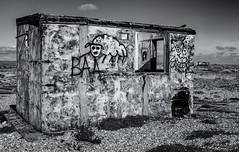Unloved (David Feuerhelm) Tags: monochrome bw blackandwhite nikkor noiretblanc schwarzundweiss blancoynegro conreast building ruin graffiti abandoned hut shed wideangle nikon d750 2470mmf28 dungeness kent uk england coast