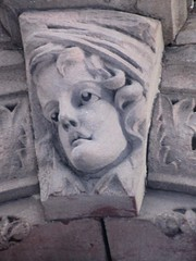 Wistful Gargoyle Face Above Doorway 4798 (Brechtbug) Tags: wistful gargoyle face above doorway building facade 25th street between 7th 8th avenues brownstone entrance nyc 11122018 new york city midtown manhattan 2018 gargoyles portraits monster portrait monsters creature faces spooky art architecture sculpture keystone mask brownstones brown stone