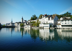 Zurich along the Limmat (blamstur) Tags: river reflection zurich switzerland buildings blue white
