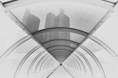 Tunnel View - Renaissance Center - Detroit, Michigan (W_von_S) Tags: renaissancecenter detroit michigan usa us unitedstates vereinigtestaaten america amerika city cityscape stadt stadtansicht architektur architecture sw schwarzweis blackwhite bw monochrome monochrom tunnel glastunnel glas glass tower türme perspektive perspective focus fokus pov wvons werner sony sonyilce7rm2 highkey symmetrie symmetry linien lines bogen symmetrisch geometrisch geometrical hochhaus skyscraper composition komposition october oktober 2018 wow blackandwhite