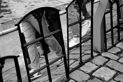 Mirrors (Von Noorden) Tags: noiretblanc black white blackandwhite bw sw schwarzweiss topv germany schwarz weiss weis schwarzweis shade monochrome plain people shorts mirror mirrors reflection reflections spiegel trousers walk walker water street streetphotography streetphoto streets art hamburg hafencity worlds copplestone cultur city kunst blackwhite schwarzundweiss tourism sidewalk pavement