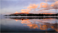 Chasing the mist.. (mandysp8) Tags: windermere thelakedistrict autumn sunrise lake buoy peachskies woods trees mountains cumbria england uk canon 750d dslr buoyant yearend18