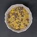 Aufsicht auf Kohlenhydratarmes Protein-Keks Schokomüsli von Layenberger auf schwarzer Schieferplatte
