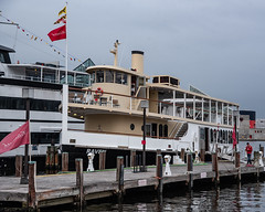 Boat_121891 (gpferd) Tags: boat flag harbor reflection vehicle water baltimore maryland unitedstates us
