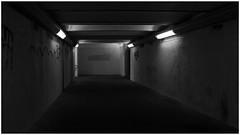 Dark path (frankdorgathen) Tags: minimalistic minimalism banal mundane alpha6000 sony sony18200mm monochrome blackandwhite schwarzweiss schwarzweis weitwinkel wideangle elektrizität electricity licht light dunkel dark ruhrpott ruhrgebiet kettwig essen haltestelle bahnhof station ubahn passage