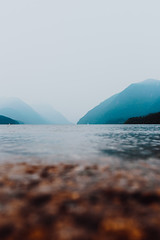 Moody (Top KM) Tags: idyllic water beautiful lake travel scenic scenery outdoors blue canada british columbia bc no person nobody explore 500px nature outside mountains haze hazy moody smoke smoky silhouette layers fog foggy landscape mountain range