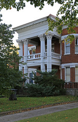 Two-Story Porch — Lexington, Kentucky (Pythaglio) Tags: house dwelling residence historic classicalrevival ca1900 portico entablature dentils denticulate columns fluting fluted corinthian capitals brick twostory ornate lexington kentucky fayettecounty bushes trees shrubbery