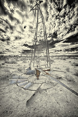 In Pieces on the Ground (magnetic_red) Tags: windmill metal structures clouds desert abandoned mojavenationalpreserve americanwest rural sky wheel