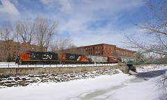 Crossing Charlevoix Street (Michael Berry Railfan) Tags: cn7226 cn7075 cn canadiannational emd gmd gp9 winter snow lachinecanal montreal eastsidecanalbank train freighttrain