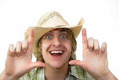 Happy Cowboy (the UMF) Tags: 20s 2025years americanculture attitude backgrounds blondehair frontview headandshoulders indoors isolatedonwhite longhair oneyoungmanonly onlyyoungmen plainbackground smiling usa whitebackground adult caucasian characters clippingpath color copyspace countryandwestern cowboy cowboyhat expression happy hat horizontal isolated lifestyle lookingatcamera male men oneperson people photograph portrait studioshot wacky white wildwest youngadult youngmen zany