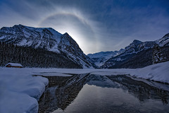 Sun flare (Robert Grove 2 (on tour)) Tags: circle round rainbow banff morning lake robertgrove canada