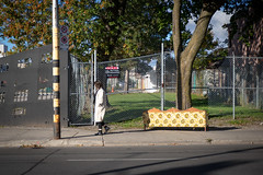 It Was All Yellow (cookedphotos) Tags: 2018inpictures toronto ontario canon 5dmarkiv streetphotography 365project p3652018 lansdowne sidewalk street couch pole yellow woman walking color