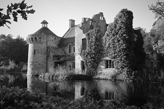 Scotney Castle BW (Henry Hemming) Tags: lamberhurst castle kent garden england uk historic house stately home ruin beauty tree building photo person moat lake reflections autumn water wood sky grass mono blackandwhite bw dilapidated forgotten whistful folly national trust english drives