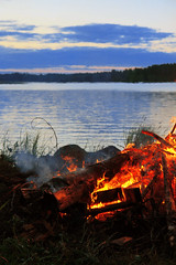 still burning (Themee89) Tags: fire water midsummer bonfire summer finland canoneos600d tradition lake cottagelife