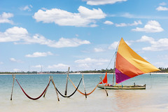 beautiful sail boat and hammocks at the Paradise Lake (Jericoacoara, Brazil) (terraexperiences) Tags: jericoacoaraoutdoorwolrdadventurecoastshoretropicalcearatravelredpeaceyellowsandsunnycuporangesummersolitudefortalezashiplaketraditionalstripedparadisetouristrecreationlagoonsailboatbeachbrazilwi boat hammock jericoacoara fortaleza brazil outdoor wolrd adventure coast shore tropical ceara travel red peace yellow sand sunny cup orange summer solitude ship lake traditional striped paradise tourist recreation lagoon sailboat beach wind 2014 colorful blue speed relax sky bay tourism sea sail resort beautiful background water nature vacation ocean terranossa brésil nordeste northeastern nossa