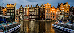 2018 - Amsterdam - Damrak Sunset (Ted's photos - Returns Late November) Tags: 2018 amsterdam cropped nikon nikond750 nikonfx tedmcgrath tedsphotos vignetting water boats buildings reflection waterreflection wideangle widescreen damrak