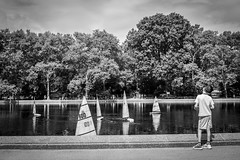 O Captain, My Captain (Phil Roeder) Tags: newyorkcity nyc manhattan centralpark blackandwhite monochrome leica leicax2 boat sailboat reflection