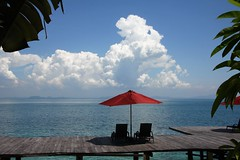holiday vibes__ (ardan dojan) Tags: island vista holiday paradise tropics calm serene ocean clouds white cloudscape fluffy red beach umbrella walkway deck chairs sunshade hot palm trees reflection relaxing sleepy sky blue seascape horizon islands landscape nature seaside