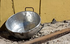 Silver and Gold 103 (LarryJay99 ) Tags: debris constructionsite yellow gold sliver pots colander lakeworth florida trash cookwear