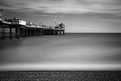 Still the moment (Anthony P.26) Tags: architecture brighton brightonpier category eastsussex england external longexposure places seascape pier travelphotography landscapephotography canon70d canon1585mm canon outdoor beach pebblebeach sea water englishchannel uk unitedkingdom mono monochrome sky whiteclouds seaside