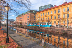 Autumn in my hometown (Fredrik Lindedal) Tags: autumn building reflection reflections train trees tram light sweden sverige leafs fall architecture lindeda fredriklindedal