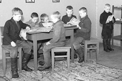 Games or reading (theirhistory) Tags: boy child kid school pupil class form student jumper trousers wellies shoes jacket chair book boots