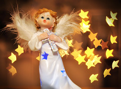 Christmas Angel (Martyn.Hayes) Tags: christmas stilllife bokeh softfocus closeup decoration xmas seasonal festive joy happy tree snow christmaslights fairylights angel fairy holy christian cross faith wings feathers cherub