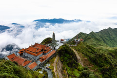 Beautiful view from Fansipan mountain with a Buddhistic temple (Evgeny Ermakov) Tags: asia asian buddha fansipan laocai pagoda sapa southeast southeastasia vietnam vietnamese architecture atmosphere beautiful beauty buddhism buddhist buddhistic building clouds cloudscape cloudy culture cultures famous forest high landscape mount mountain mountains nature outdoor outdoors peak rainforest religion religious scene scenery scenic sight sky spirituality temple tourism touristic tradition traditional travel vibrant view woods aerialshots