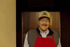 Allen Askew smiles at the camera as he walks from the grilling room to the kitchen.