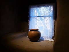 """Inside the """"Oldest House"""" (Garry9600) Tags: lumix fz200 santafe newmexico usa house architecture ancient pueblo adobe pottery window curtain lace museum indoor"""