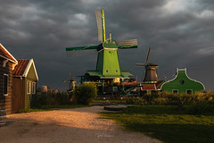 The Crowned Poelenburg. (rudi.verschoren) Tags: poelenburg sawmill sunrise sky cloudsstormssunsetssunrises zaandam dike outdoor old holland heritage clouds sun painterly picturesque mood autumn europe exposure tall yellow overlooking green red landscape light lines museum mills morning mist water walkway canon contrast colors blue