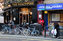The Porcupine (iwys) Tags: the porcupine pub leicester square tube station street scene bicycles