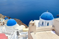 Oia, Santorini, Greece. (Chanel Debono) Tags: santoini thera thira volcano caldera volcanic greece greekisland greekislands greek island islands cyclades aegean aegeansea hills cliffs sea beach beaches sand summer blue ferries hellenic hellenicseaways ferry trees cactus flower flowers gazebo hotel boats ships quadbike atv quads quadbikes bike windmill windmills maintown town holiday travel travelling lovegreece visitgreece greecetrip islandhopping discovergreece travelphotography canon canon600d canonphotography chaneldebono church churches traveler wanderlust travellingtheworld photography nature bluesky europe oia bluedomes dome bluedome santorinidomes threebluedomes