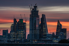A New Dawn... (Aleem Yousaf) Tags: heron tower tower42 natwest 22 bishopsgate gherkin cheesegrater scalpel modern buildings new dawn morning skyline lloyds london windows glass steel cranes construction light shadows reflections sky golden hour sunrise fire clouds waterloo bridge traffic westminster nikon nikkor 200500mm skyscraper londonist londoner ambient digital camera world capital city flickr vantage autumn warm cars fun brown dof composition sunlight frame hungerford